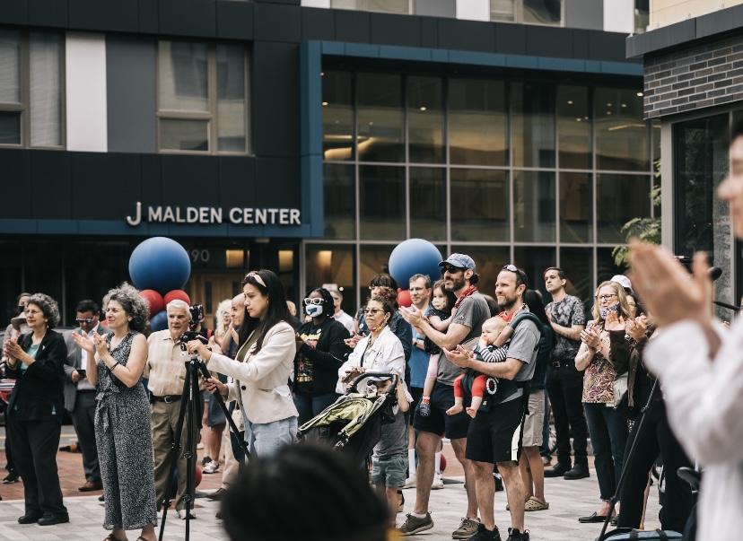 Crowd at flag raising for Juneteenth outside J Malden Center in Malden.